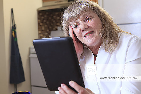 Woman with Bipolar disorder working from home on her tablet