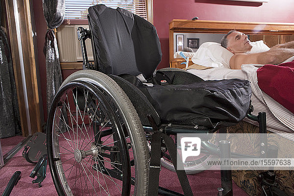 Man with spinal cord injury sleeping on the bed