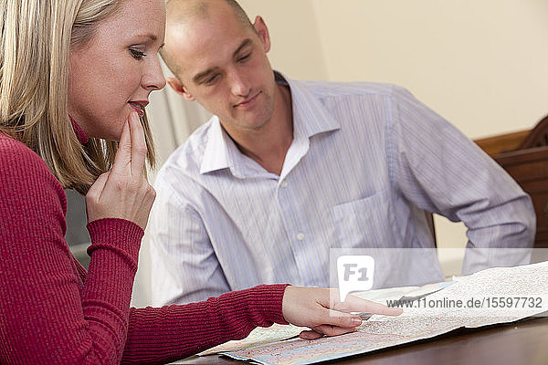 Couple in a restaurant looking at a map