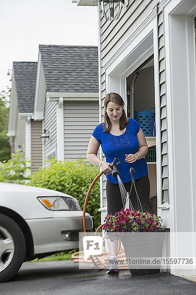 Young Woman with Cerebral Palsy watering her flowers