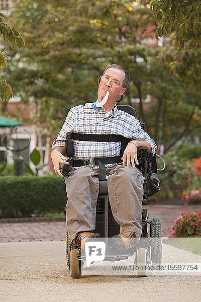 Man with a Duchenne muscular dystrophy sitting in a wheelchair