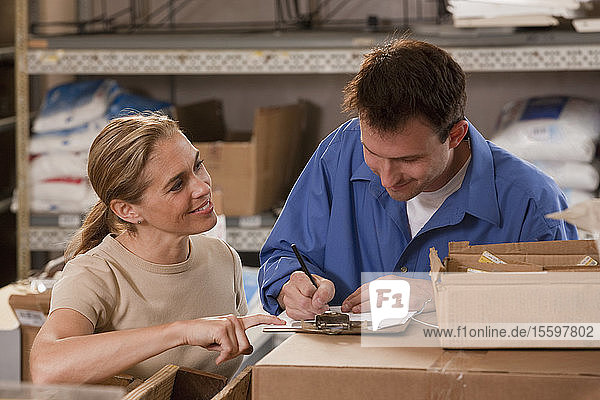 Supervisors placing orders in a hardware store