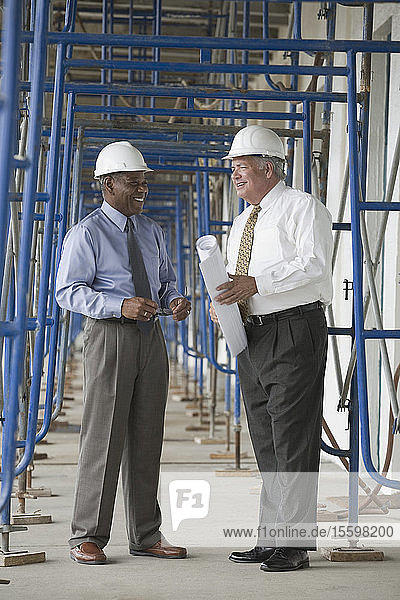 Two engineers at a construction site