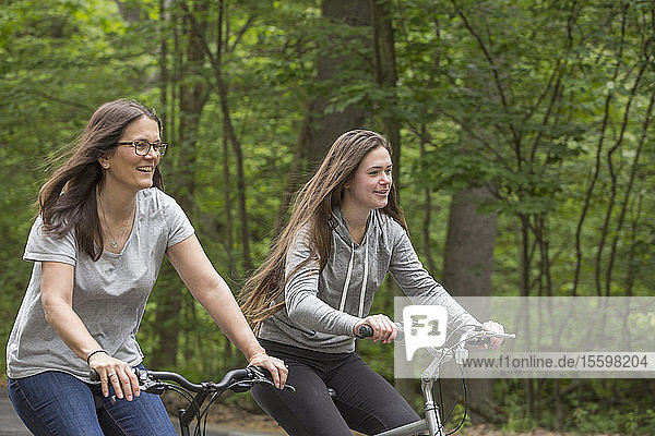 Woman with Multiple Sclerosis biking with her daughter