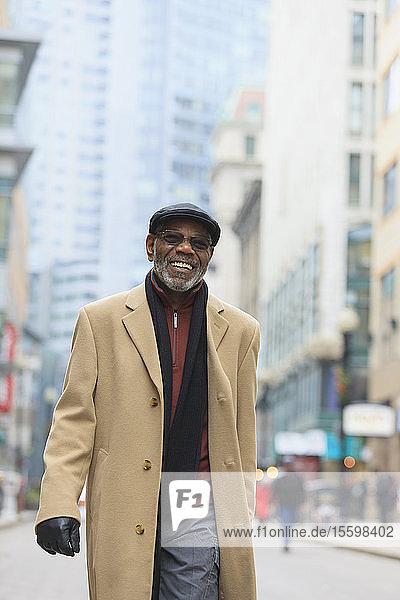 Man walking down city street  Boston  Suffolk County  Massachusetts  USA Man walking down city street, Boston, Suffolk County, Massachusetts, USA
