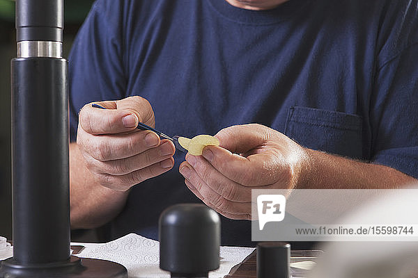 Engineer installing new membranes in an O2 electrochemical sensor probe in a laboratory