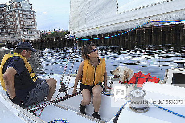 Couple with visual impairment and service dog on sailing boat