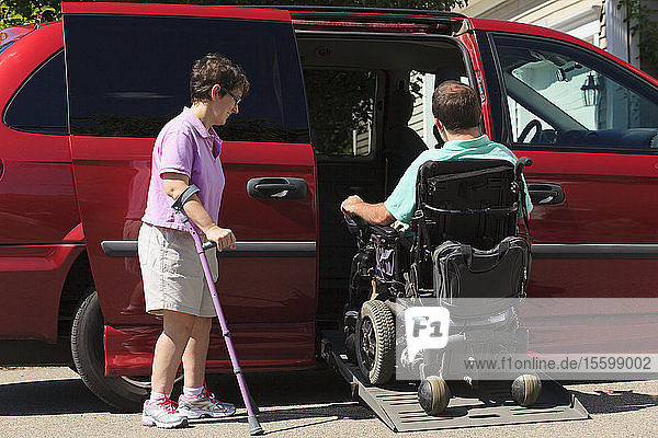 Couple with Cerebral Palsy getting into an adaptive vehicle