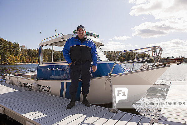Security guard standing at a dock
