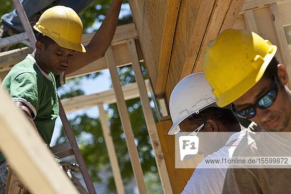 Carpenters preparing laminated beam