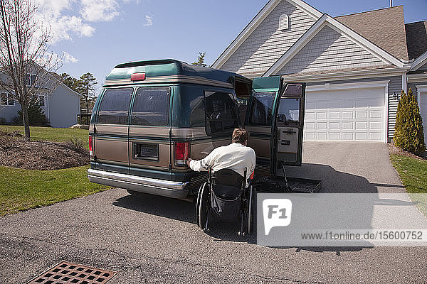 Man with spinal cord injury using magnetized remote to open his accessible vehicle