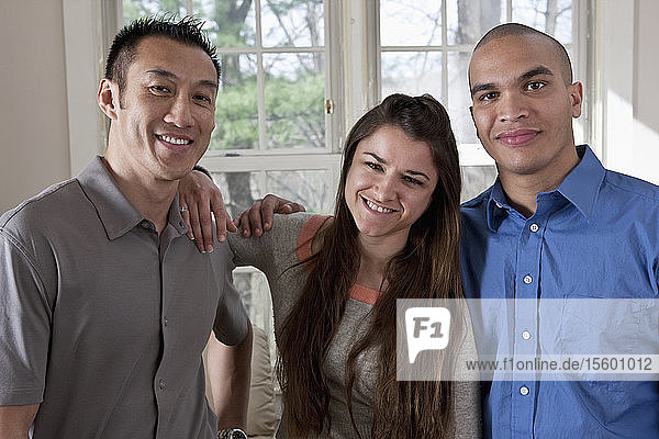 Portrait of an Hispanic couple with their friend