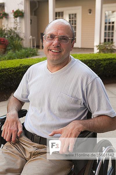 Man with Friedreich's Ataxia sitting in a wheelchair