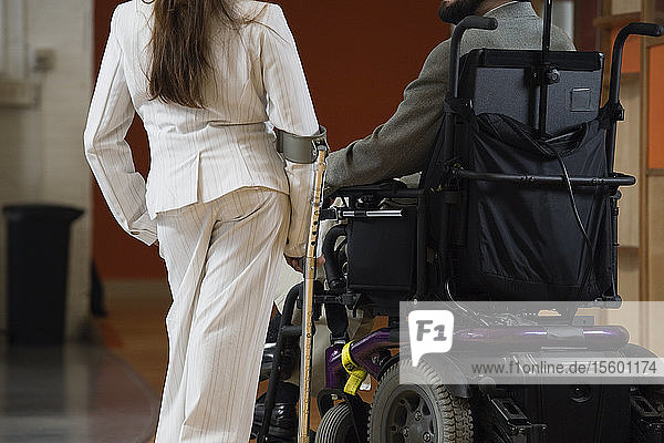 Man with Cerebral Palsy and woman with cane