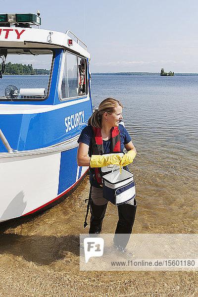 Public works engineer preparing to take public water samples from reservoir