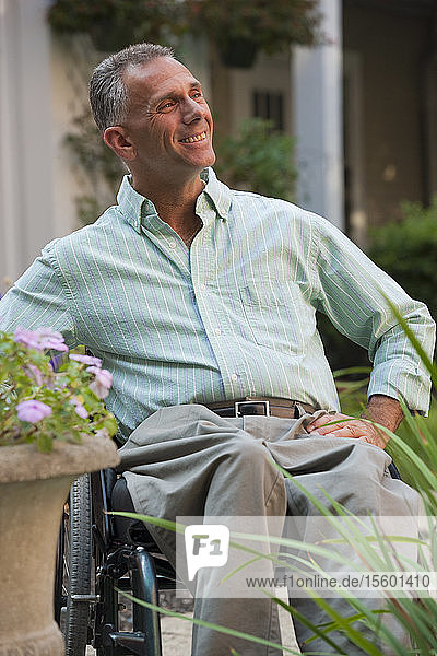 Man with spinal cord injury sitting in a wheelchair