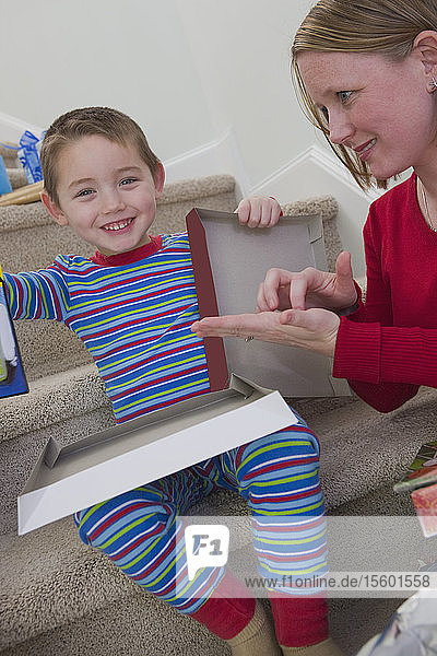 Woman signing the word 'Calculator' in American Sign Language while communicating with her son