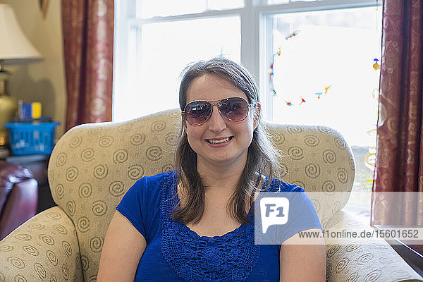 Young Woman with Cerebral Palsy smiling at home