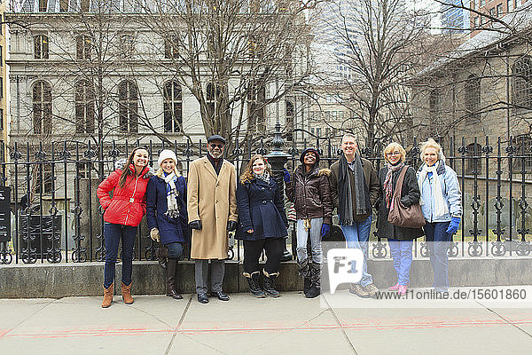 Tourists standing in front of The King's Chapel Burying Ground historic site  Boston  Suffolk County  Massachusetts  USA