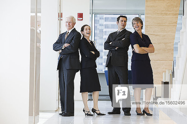 View of businesspeople smiling in an office.