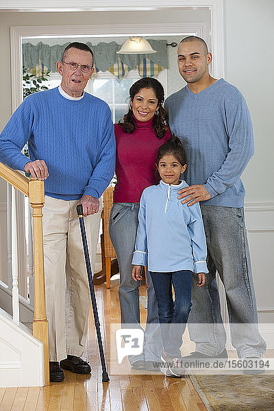 Family standing together and smiling  man with Parkinson's Disease