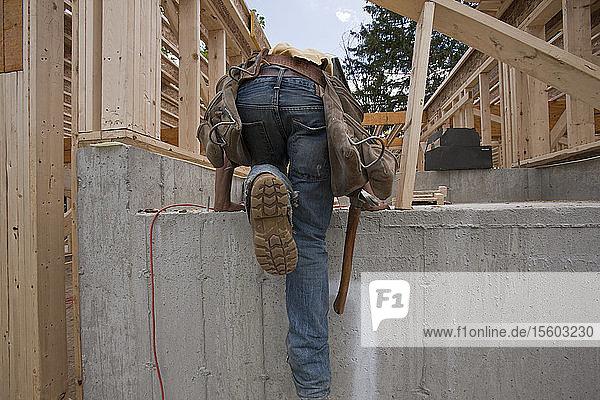 Carpenter inspecting foundation