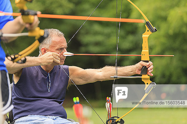 People with disabilities during archery practice