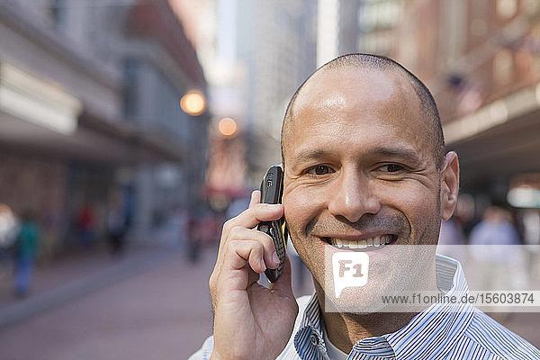 Hispanic man talking on a mobile phone