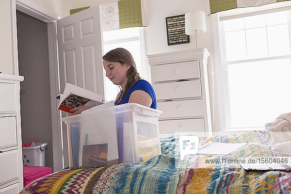 Young Woman with Cerebral Palsy studying in her room