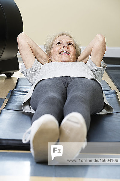 Senior woman exercising in the gym.