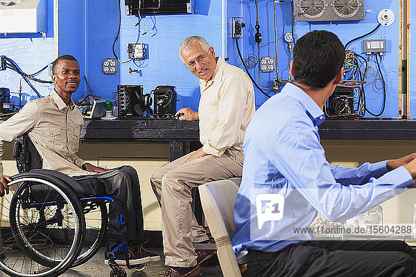 Instructor discussing HVAC system operation with students one student in wheelchair