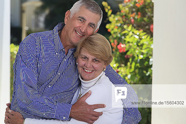 Romantic senior couple embracing each other
