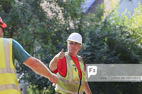 Construction supervisor giving 'thumb up' gesture