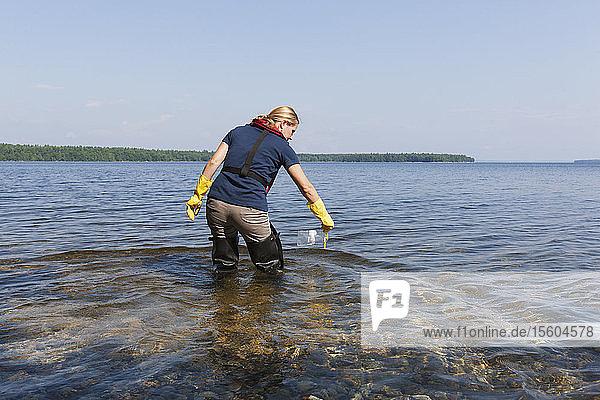 Public works engineer taking water samples from reservoir