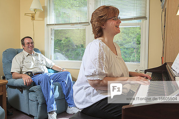 Woman with RSD playing her piano for her husband