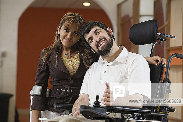 Portrait of a man with Cerebral Palsy and woman smiling