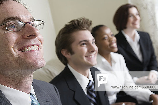 View of business people smiling.