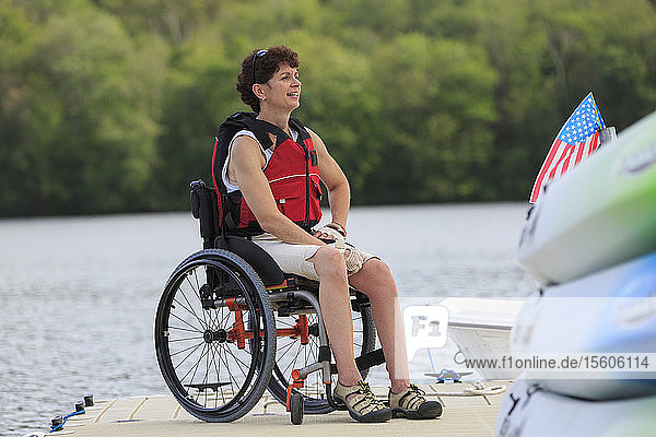 Woman with a Spinal Cord Injury in a wheelchair on a boat dock