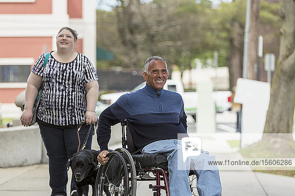 Man with Spinal Cord Injury and his daughter  who is Blind