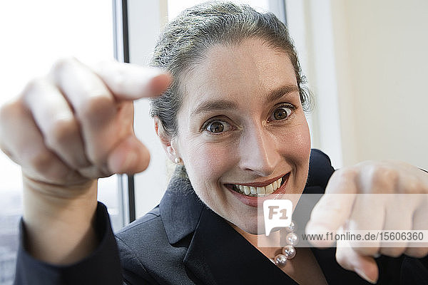 Portrait of businesswoman smiling in an office.