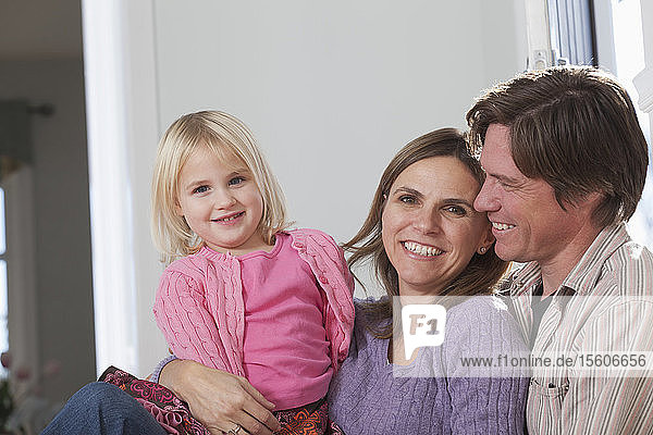 Happy couple with their daughter