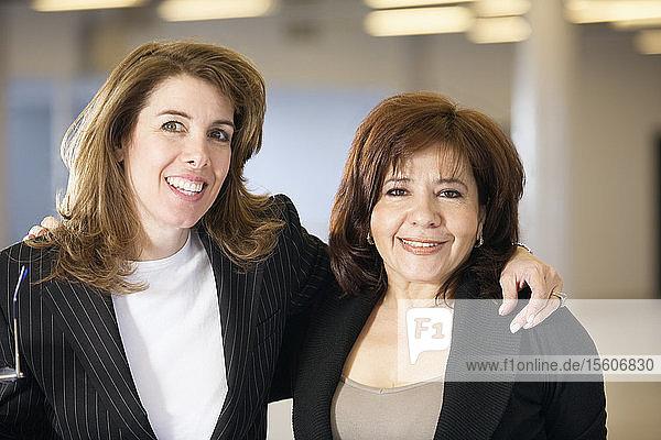 Portrait of two smiling women.