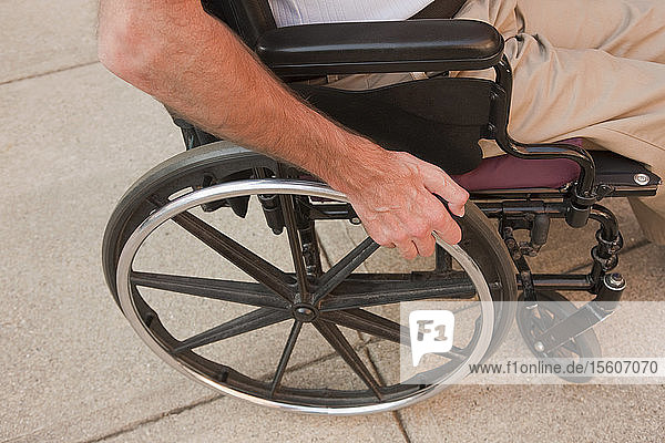 Man with a Friedreich's Ataxia sitting in a wheelchair