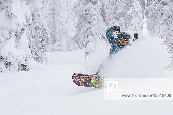 Snowboarder Snowboarding In Snow