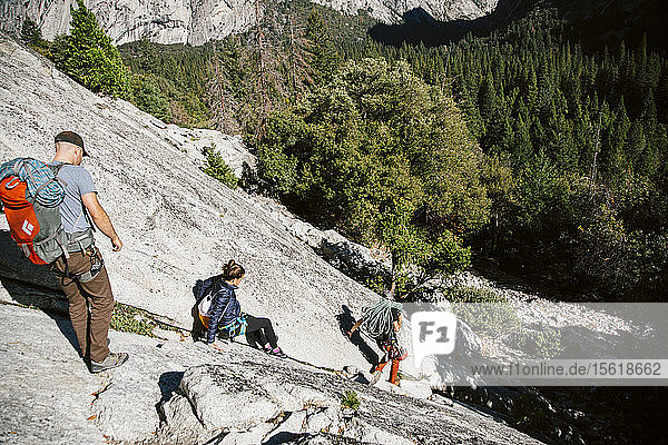 Climbers leaving The Grack (5.6) in Yosemite Valley.