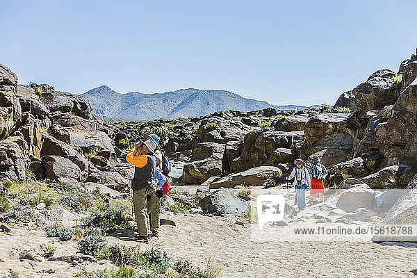 Tourists taking photographs in Little Petroglyph Canyon  Ridgecrest  California  USA