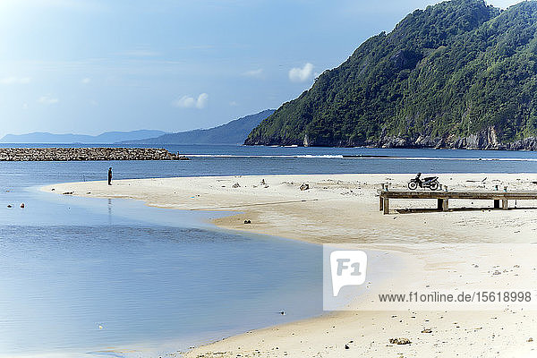 View of beach with motorcycle on wooden pier  Banda Aceh  Sumatra  Indonesia