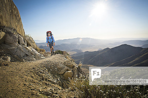 A Young Man Hiking On Rocky Section Of The Pacific Crest Trail Near Mount Laguna  California  Usa