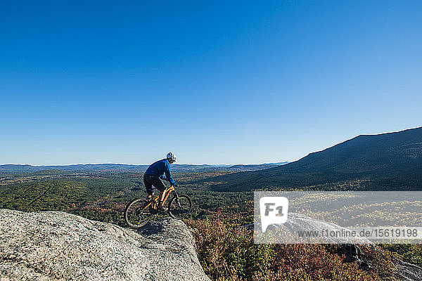 Mountain Biker On The Edge Of Bare Granite Slabs In New Hampshire