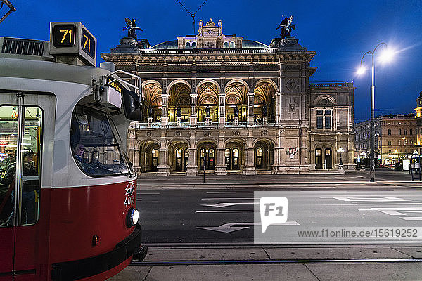 Illuminated Vienna State Opera at night with tramway in foreground  Vienna  Austria